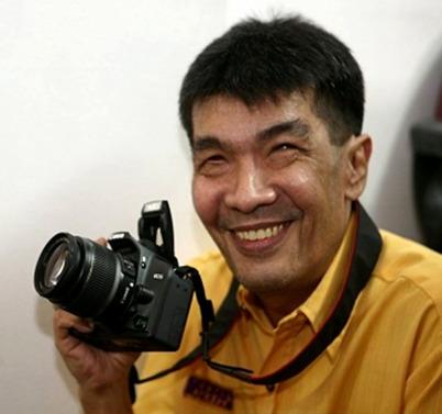 Photo of Tony Llanes with camera