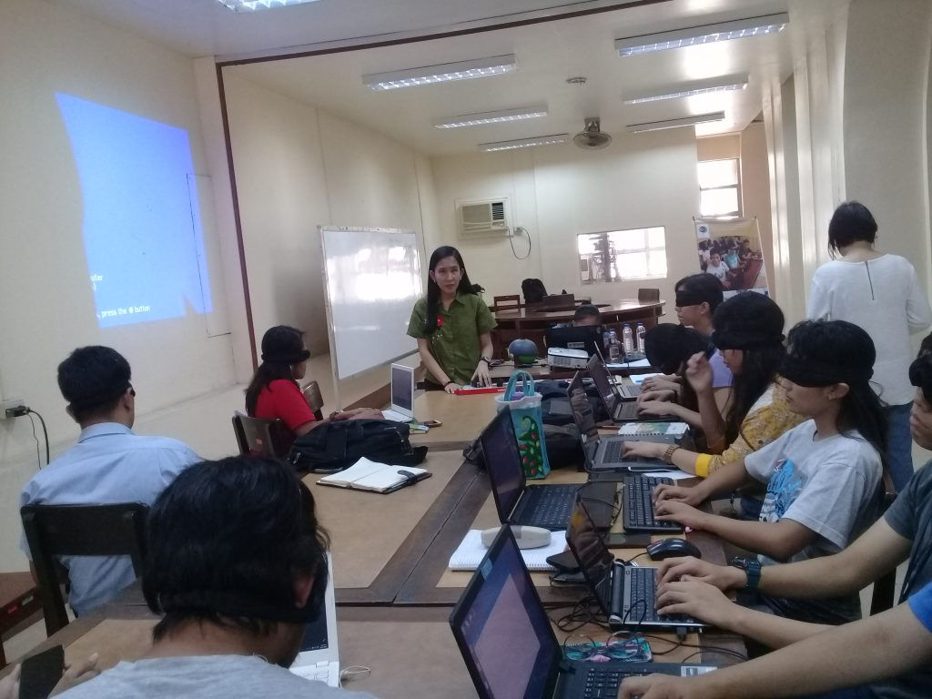 Photo of Michelle Lagartera teaching trainers from UP
