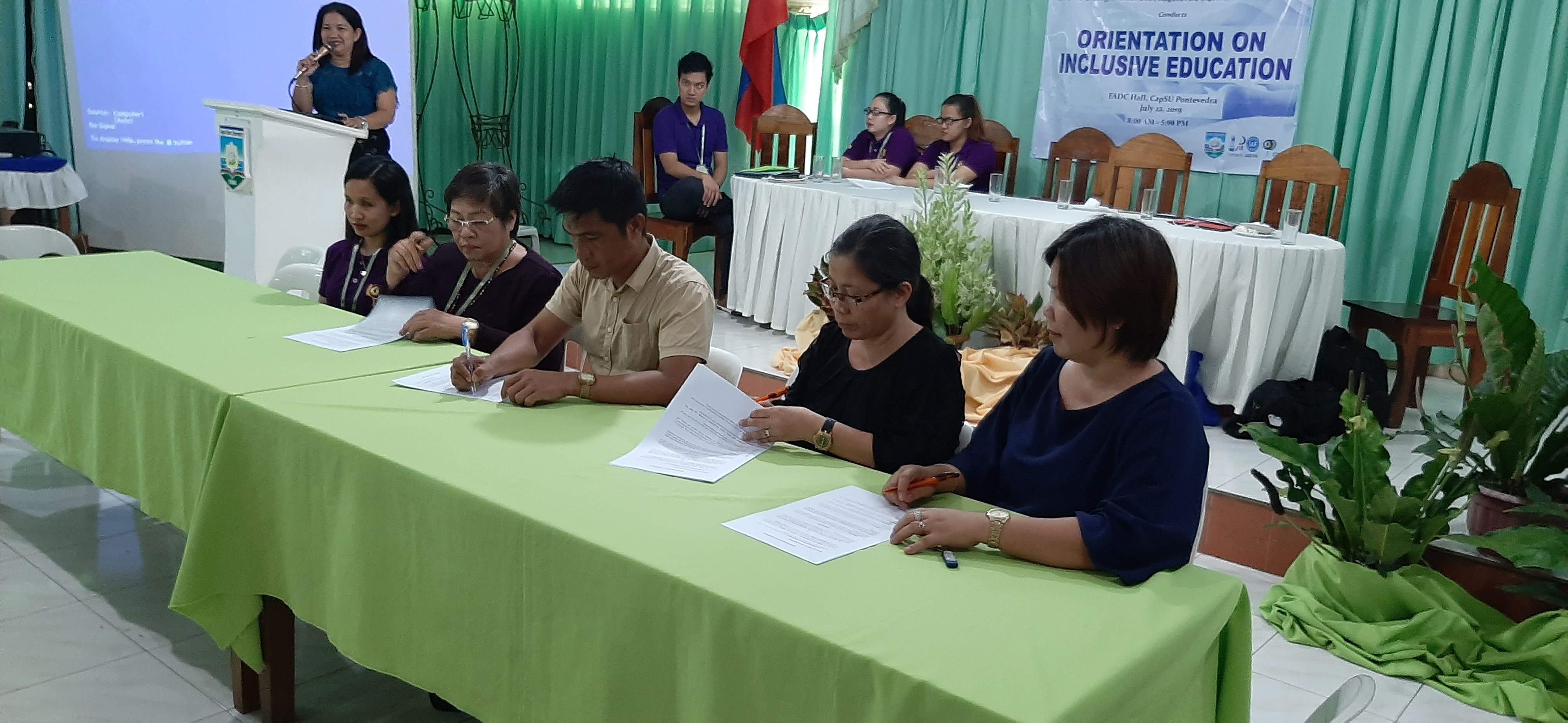 Image contains Ms. Lourdes Borgonia (ATRIEV's program coordinator), Dr. May Dumapig (campus administrator), Dr. Judel Protacio (dean of College of Education, Arts and Sciences), Ms. Sandra Escabarte (CapSU Pontevedra Extension in-charge), and Dr. Matilde Tonel( extension coordinator) signing the MOA contract.