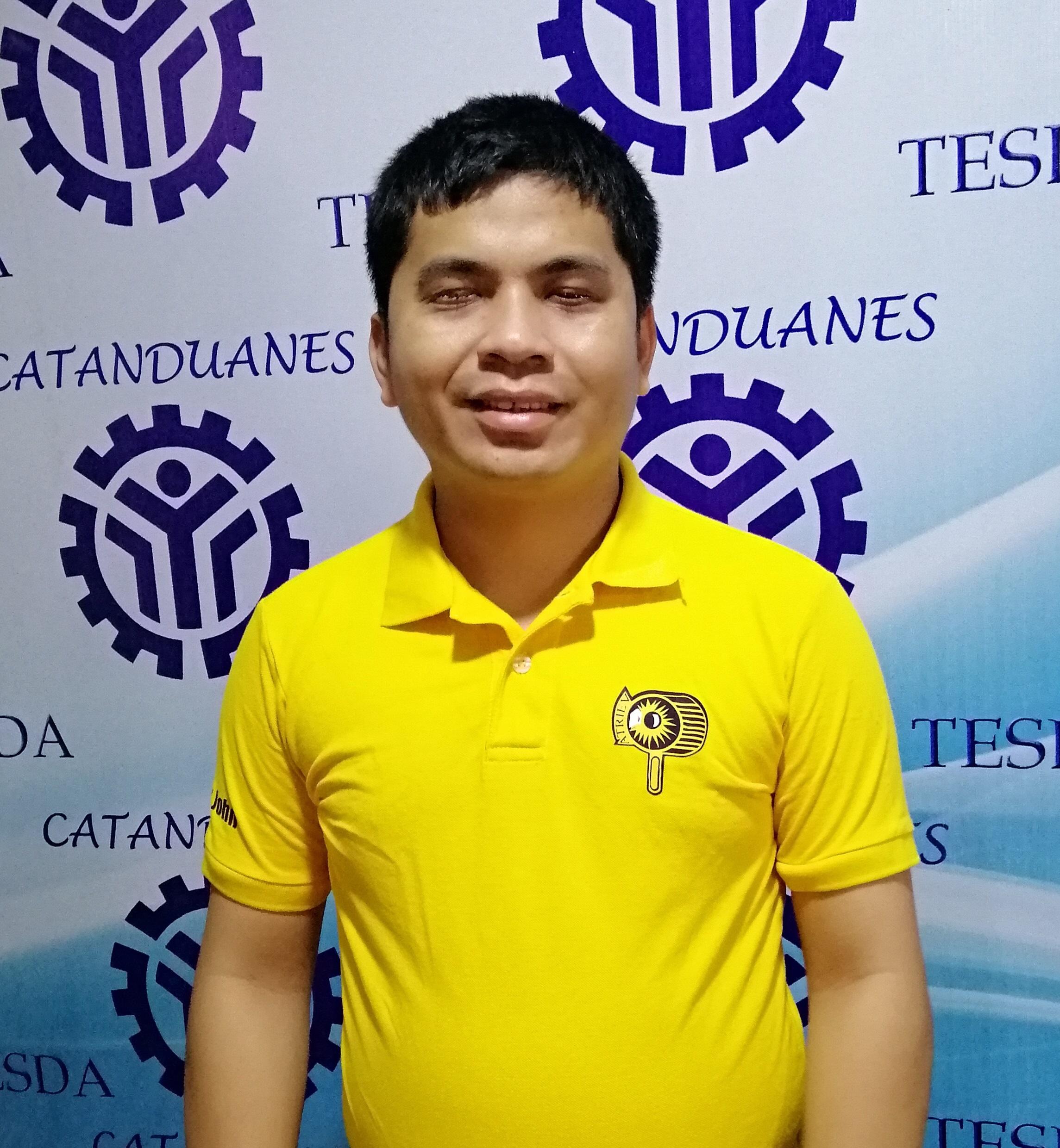 Sir Haber Jhon wearing the ATRIEV yellow polo shirt