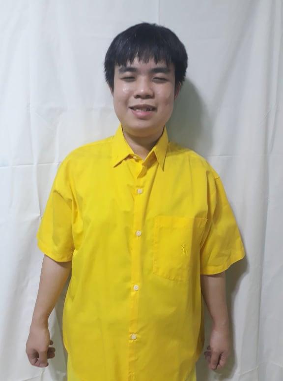 Sir Joshua Christian wearing a yellow polo shirt