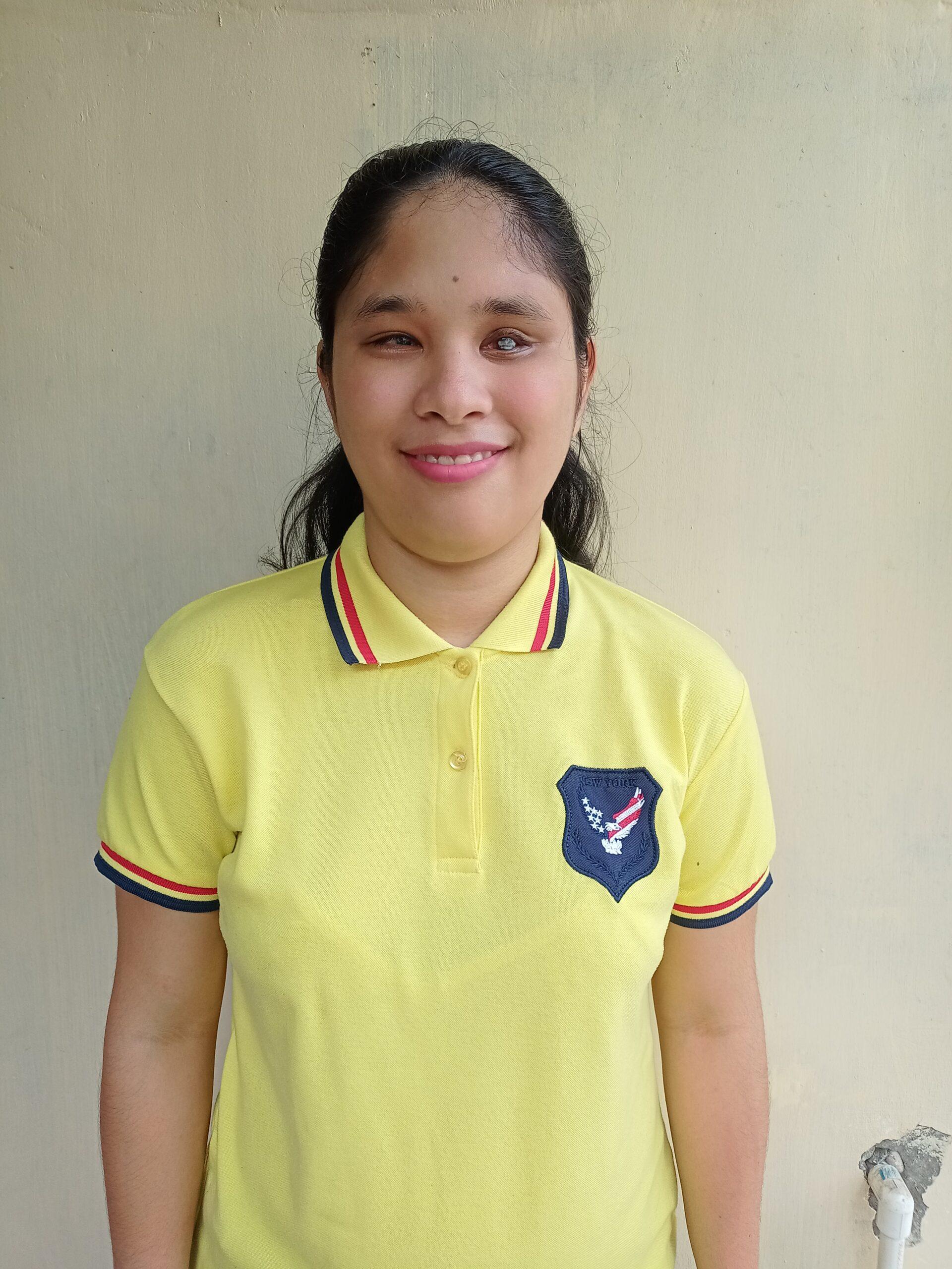 Ms. Rachele wearing a yellow polo shirt