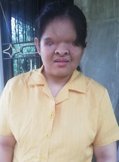 Ms. Rocel wearing a yellow polo shirt