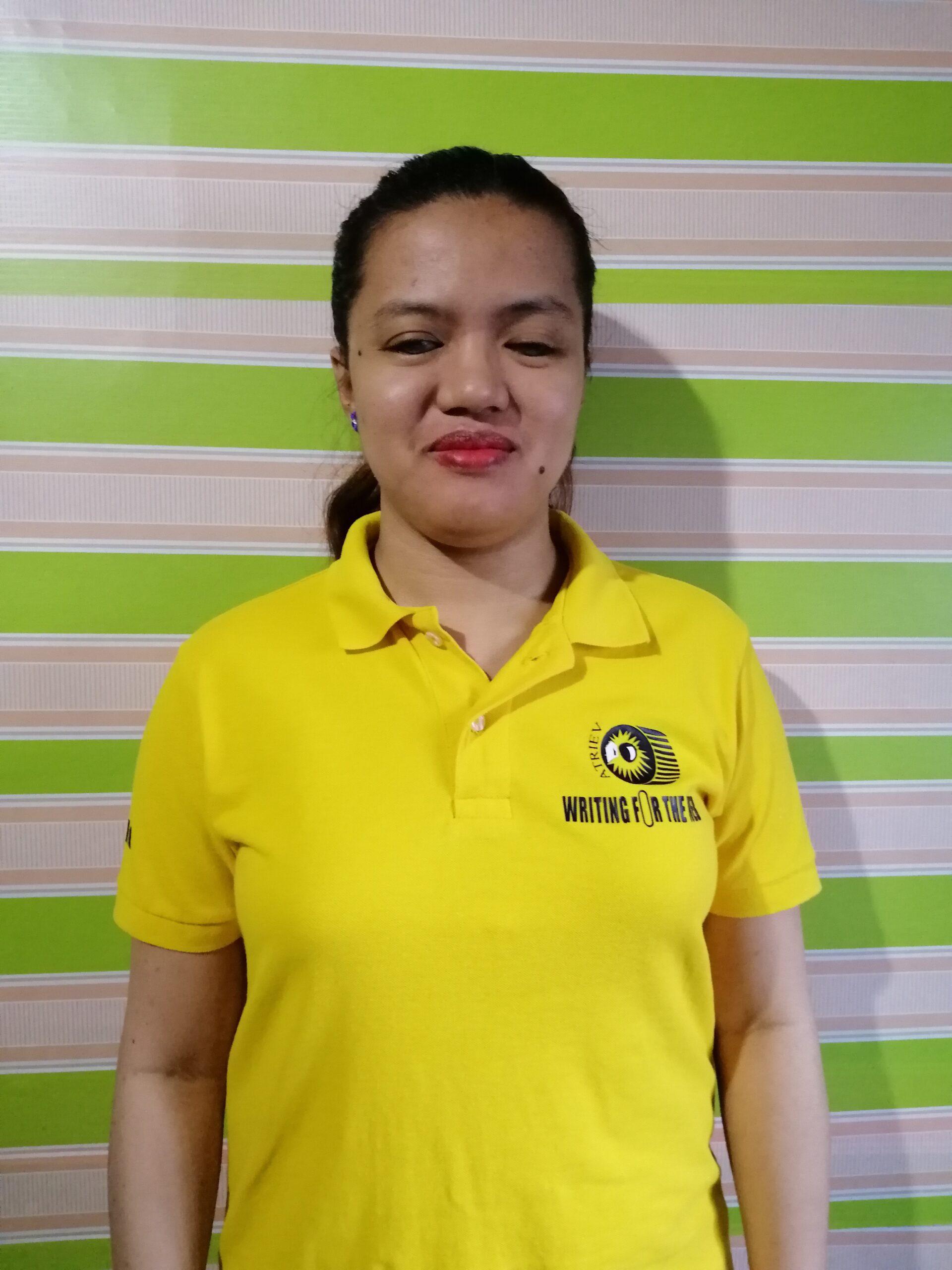 Ms. Jaelene Cristel wearing the ATRIEV yellow shirt